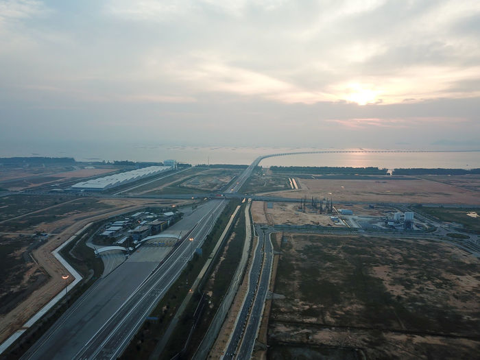 High angle view of highway against sky during sunset