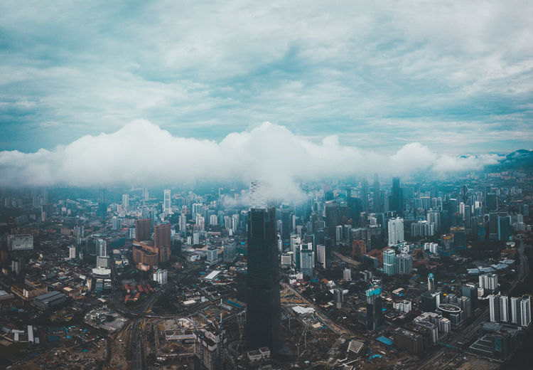 High angle view of modern buildings in city against sky in kuala lumpur, malaysia