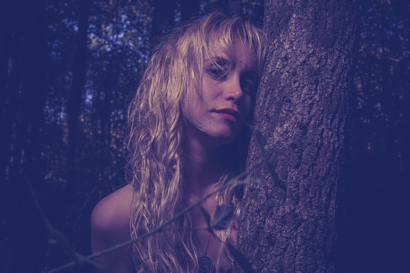 Adult Beautiful Woman Beauty Blond Hair Close-up Long Hair Looking At Camera Nature Night One Person Outdoors People Portrait Real People Tree Tree Trunk Young Adult Young Women The Portraitist - 2018 EyeEm Awards