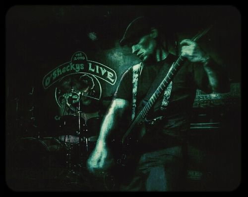 Guitarist for Levity In Action, Dan Larson, tearing it up on stage at O'Sheckys in Columbus, Ohio. Guitar Live Music O'Sheckys Levity In Action-Pic by Faith Formyduval. My edit.