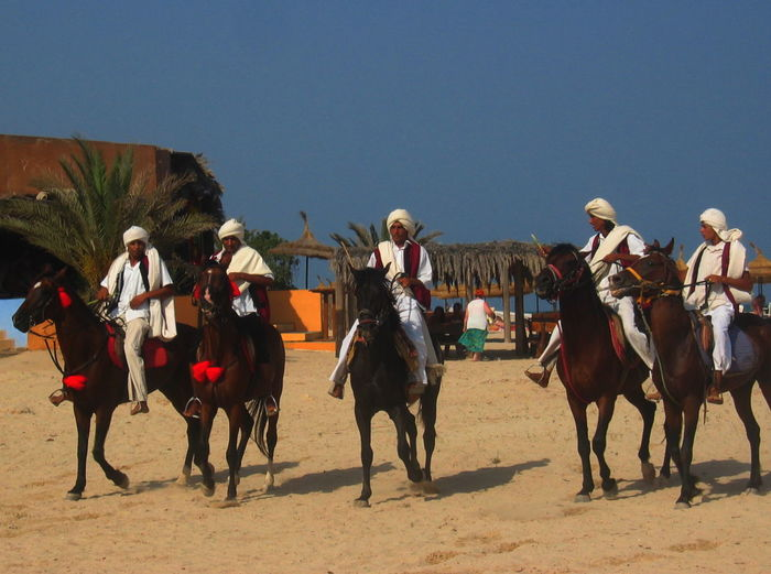 Cavaliers Horses Tunisia Arts Culture And Entertainment Day Djerba  July 2005 Outdoors Sand Sky White Suits