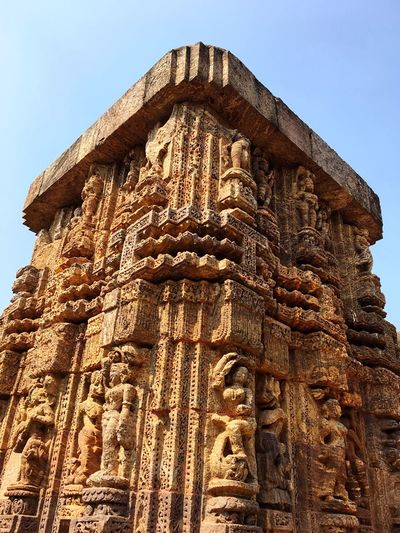 Architecture Low Angle View Built Structure Religion Building Exterior Outdoors Spirituality Clear Sky Place Of Worship Human Representation No People Day History Ancient Sculpture Sky Ancient Civilization Statue Konark