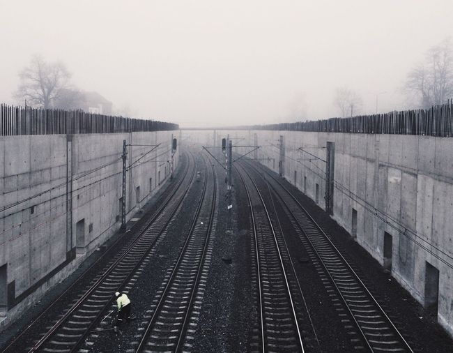 Railroad track in foggy weather