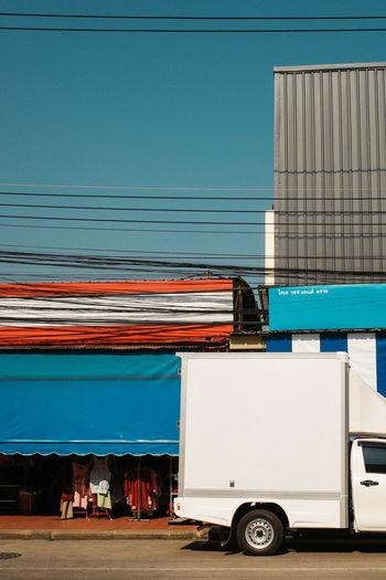 Vintage car on road against blue sky