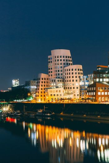 Düsseldorf Medienhafen Gehry Building Exterior Architecture Built Structure Illuminated Sky Water Building Copy Space Clear Sky Nature No People River Cityscape Reflection Waterfront Night Outdoors Apartment City Residential District