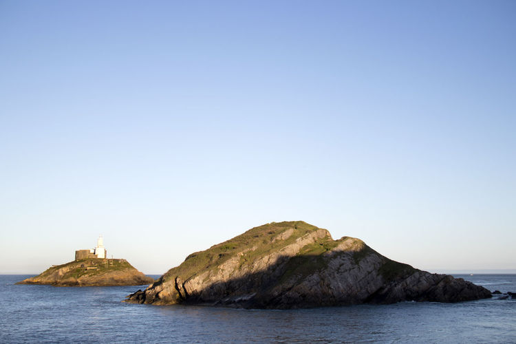 Mumbles Lighthouse Architecture Beauty In Nature Blue Clear Sky Copy Space Day Land Nature No People Outdoors Rock Scenics - Nature Sea Sky Tower Tranquil Scene Tranquility Travel Travel Destinations Water