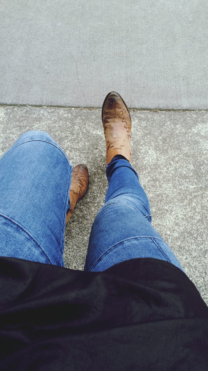 Low Section Of Woman In Jeans On Street