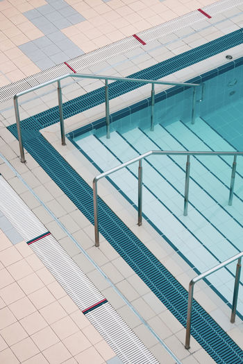 High angle view of steps in swimming pool against building