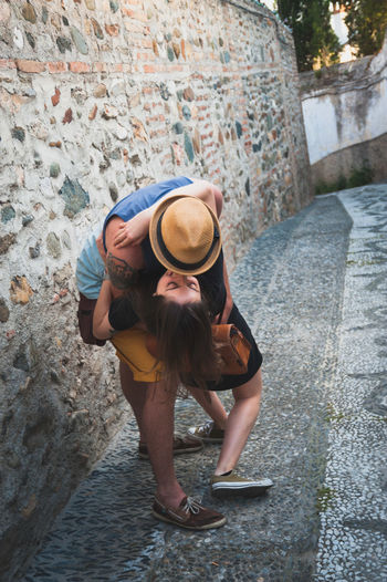 Young Couple Kissing On Footpath
