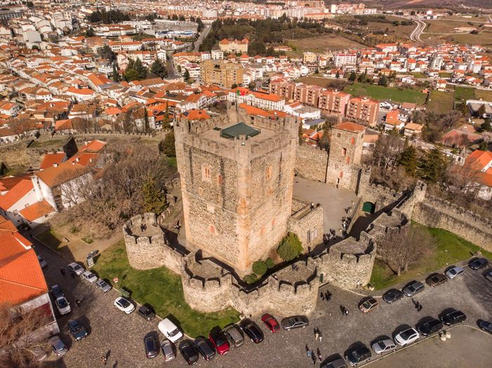 Castle of Bragança from above Drone Photograph DJI Mavic Air DJI X Eyeem High Angle View Architecture Building Exterior Built Structure City Nature Day Travel Destinations Crowd Incidental People Town Shadow Cityscape Building Outdoors Plant History Sunlight Aerial View
