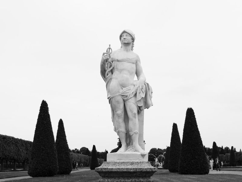 Statue Sculpture Monument Travel Destinations Human Representation History Male Likeness Tourism Memorial Travel Petergof Russia Monochrome St Petersburg architecture Arts Culture And Entertainment City Outdoors Sky People Day