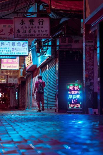 One Person One Man Only Signboard Neon Lights Moodygrams Tsuen Wan Architecture Built Structure Real People Full Length Building Exterior Illuminated Text Communication Standing City Lifestyles Non-western Script Sign Script Men Western Script Leisure Activity Casual Clothing EyeEm Best Shots
