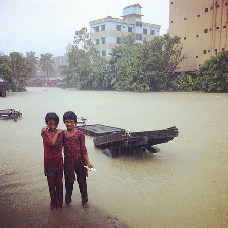 water world ! two girl child crossing a flooded street during heavy tidal surge in chittagong. Js Jashimsalam Waterworld Tidal Tide Flood Surge Climatechange Risingsealevel Photojournalism Documentary Flood Tidal Surge Opensociety Visura @visura.co.Portrait Chittagong Chottogram Everydayclimatechange Everydaybangladesh