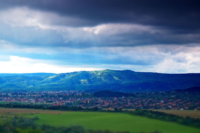 Only the hilltop is in the sun Beauty In Nature Cloud - Sky Clouds And Sky Day Field Hill Idyllic Landscape Light And Shadow Mountain Mountain Range Nature No People Outdoors Pilisszántó Scenics Sky Thunderstorm Tranquil Scene Tranquility