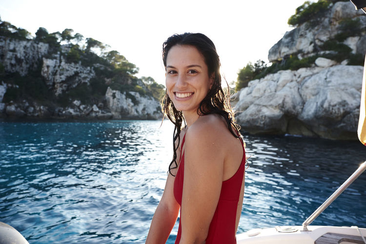 Portrait of smiling young woman in boat