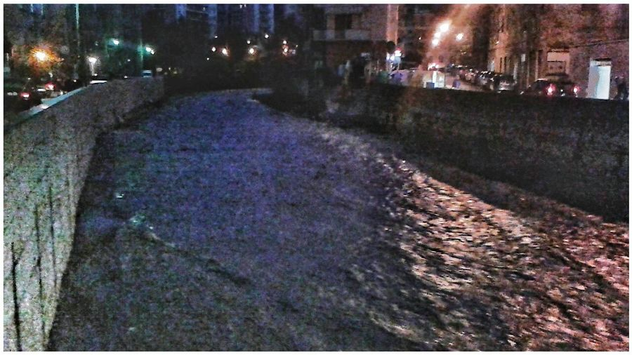 Torrent swollen with rain. One hour early it was nearly flooding out. ... Torrente Torrent Torrential Rain Rainy Days Running Water Nigh Photography Smartphone Photography Mobilephotography S3 Mini Night Town Neighbourhood City Water Illuminated Built Structure