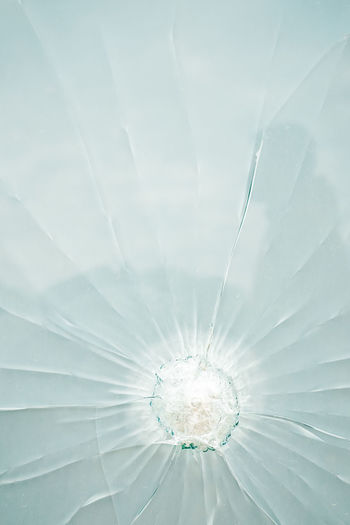 Low angle view of broken glass ceiling