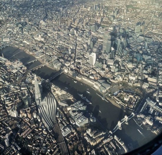 Aerial view of city and buildings seen through airplane window