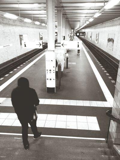 People on railroad station platform