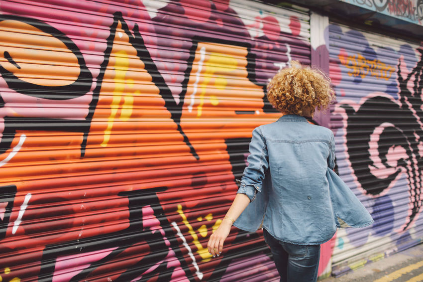 Blonde Brighton Casual Clothing Colorful Curly Hair Day Girl Graffiti Graffiti Art Joyful Jumping Leisure Activity Lifestyles Multi Colored Playful Spinning Art Is Everywhere