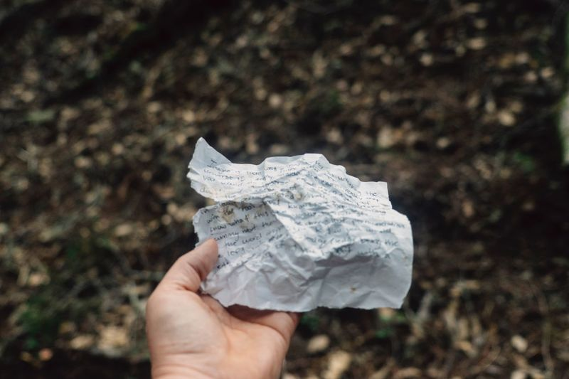 Close-up of hand holding crumpled paper