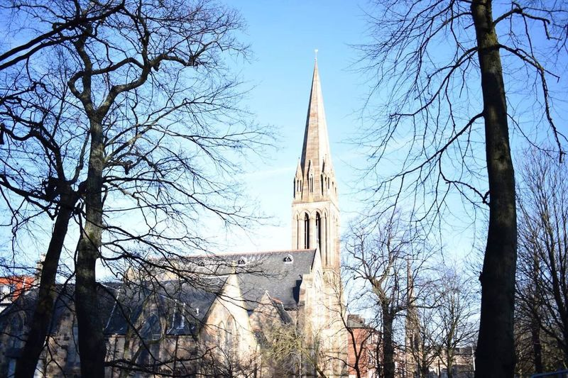 Architecture Religion Tree Place Of Worship Built Structure Low Angle View Bare Tree Glasgow  Spirituality Tower Outdoors Travel Destinations Sky Building Exterior Day Branch No People Clock Tower