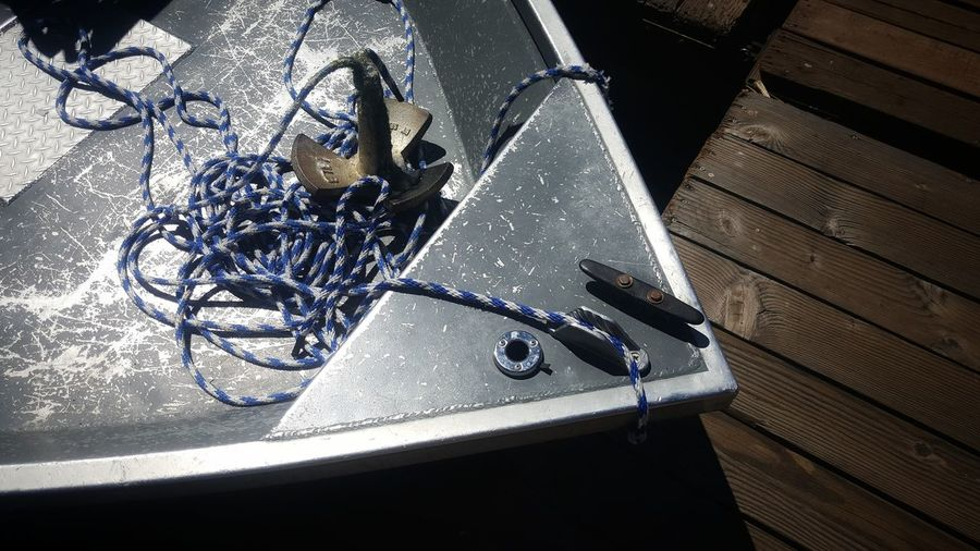 High angle view of old metal on table at home