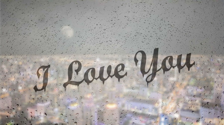 Draw letters I love you by hand on a glass with water drops droplets with night cityscape background. Text Western Script Communication Wall - Building Feature No People Message Built Structure Capital Letter Architecture Indoors  Close-up Backgrounds Wall Graffiti Full Frame Script Sign Glass - Material Non-western Script Information Love Valentine's Day  Water RainDrop Cityscape