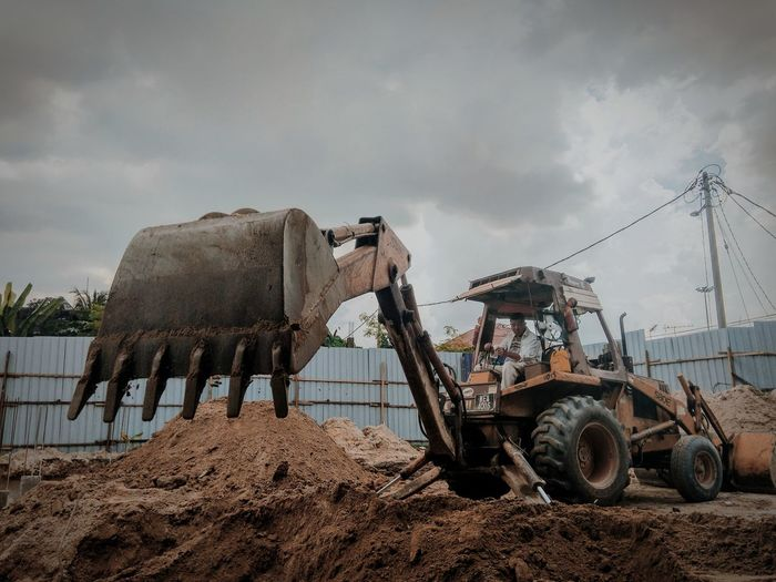 Man in bulldozer working at construction site