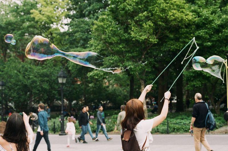 Woman making bubble at park