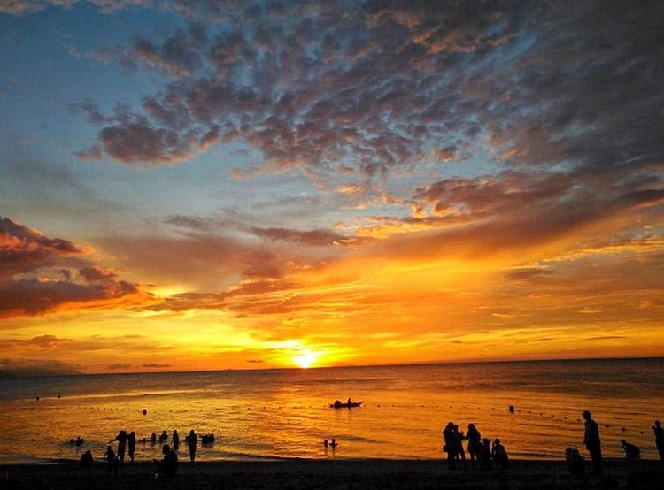 A borrowed sunset... Silhoutte & Sky Eyeemphotography Sunset_collection Clouds And Sky Cloudscape Sunrise_sunsets_aroundworld EyeEm Nature Lover Eyeem Philippines Sunset Sky Water Sea Beach Cloud - Sky Beauty In Nature Scenics - Nature Orange Color Outdoors