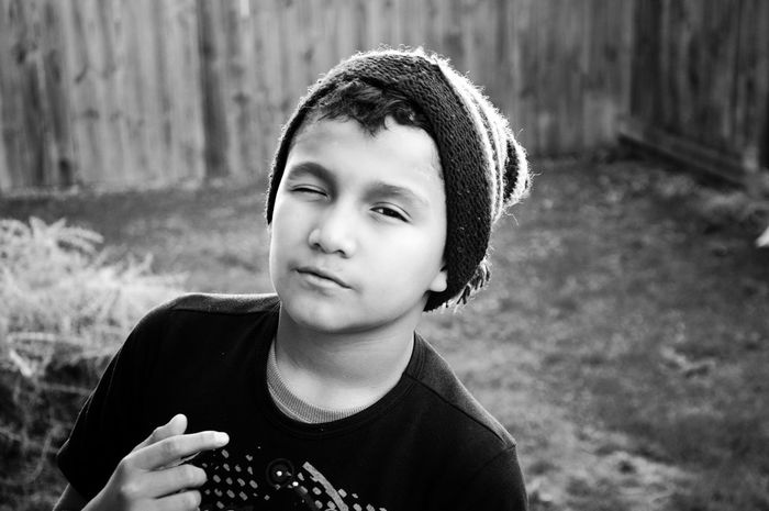 My brother modeling in B&W / Mi hermano modelando en Blanco y Negro. Modeling Brother Kid Black And White Wink Yard Happiness Children Only Child Portrait Outdoors Front View Boys Modelando Hermano Niño Blanco Y Negro Guiño Patio Felicidad The Week On EyeEm Black And White Friday Fashion Stories This Is Masculinity