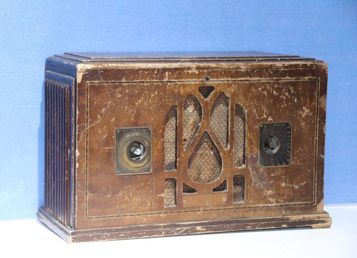 Close-up of old box against blue background