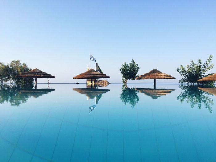 Water Clear Sky Tranquil Scene Tranquility Built Structure Architecture Reflection Outdoors Nature No People Blue Scenics Day Waterfront Beauty In Nature Stilt House Sea Sky