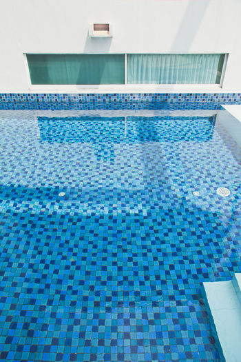 detail image of swimming pool in modern house outdoor. Modern House Blue Day Indoors  Luxury No People Poolside Swimming Lane Marker Swimming Pool Tile Tourist Resort Vacations Water