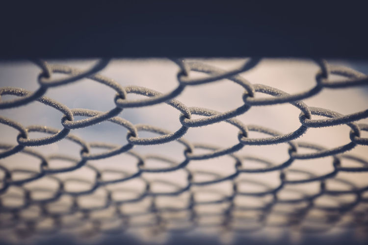 Close-up of frozen chainlink fence