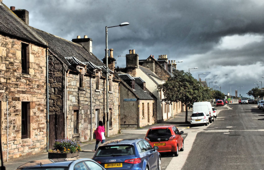 Village of Invergordon - Cromarty, Scottish Highlands Architecture City Sky Car Tree Day Road Outdoors Transportation Shops Stormy Sky Storm Cloud No People Painted Houses Mode Of Transport Street Scenes Invergordon Cloud - Sky Building Exterior Built Structure Land Vehicle