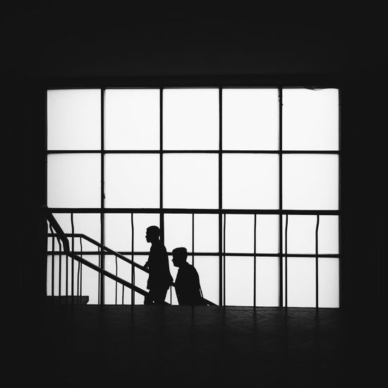 Silhouette People Standing In Window