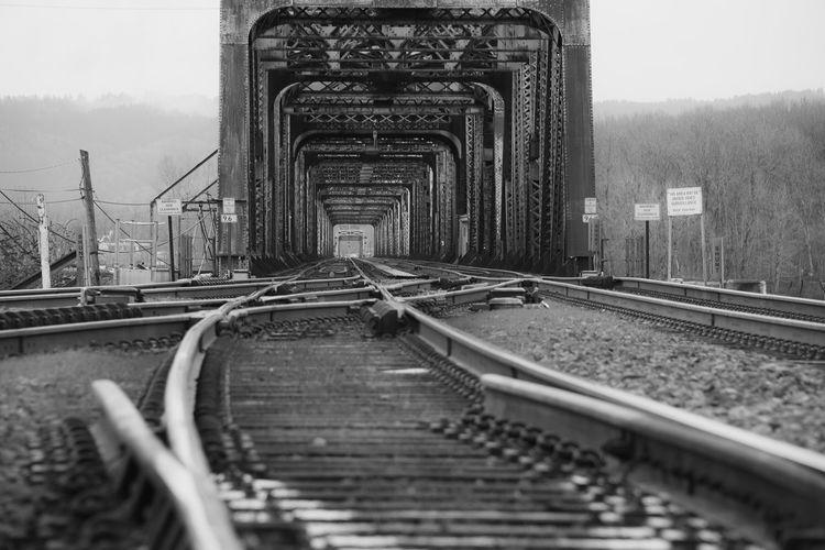 Surface level of railroad tracks against bridge