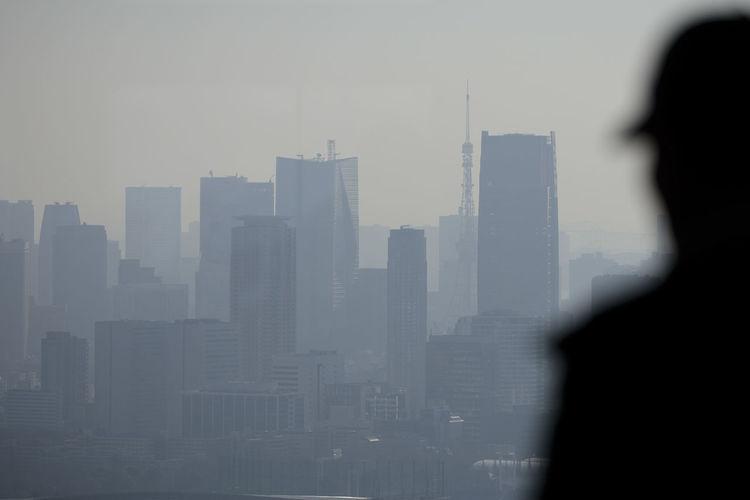 Silhouette buildings against sky in city