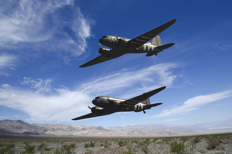 Two Lockheed Dakotas over Navada desert Air Force Air Vehicle Airplane Blue Cloud - Sky Dakota Planes Day Fighter Plane Flying Lockheed Low Angle View Mid-air Military Military Airplane Nature No People Outdoors Sky Transportation WWII Let's Go. Together.