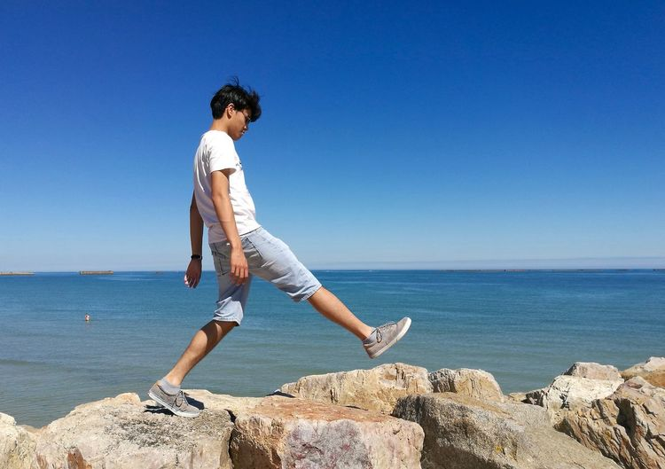 Do the walk Day Horizon Over Water Leisure Activity Lifestyles Outdoors Rock Rock Formation Sea Sky Sunny Day Vacations Walking Water Young Adult Color Of Life! Color Of Life Colour Of Life