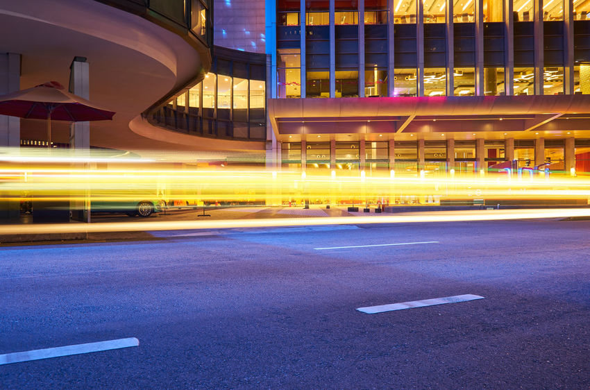 Architecture City Road Built Structure Transportation Building Exterior Illuminated Street No People Symbol Light Trail Long Exposure Sign Speed Blurred Motion Night Building Motion Marking City Life Outdoors Modern Cityscape Office Building Exterior Light