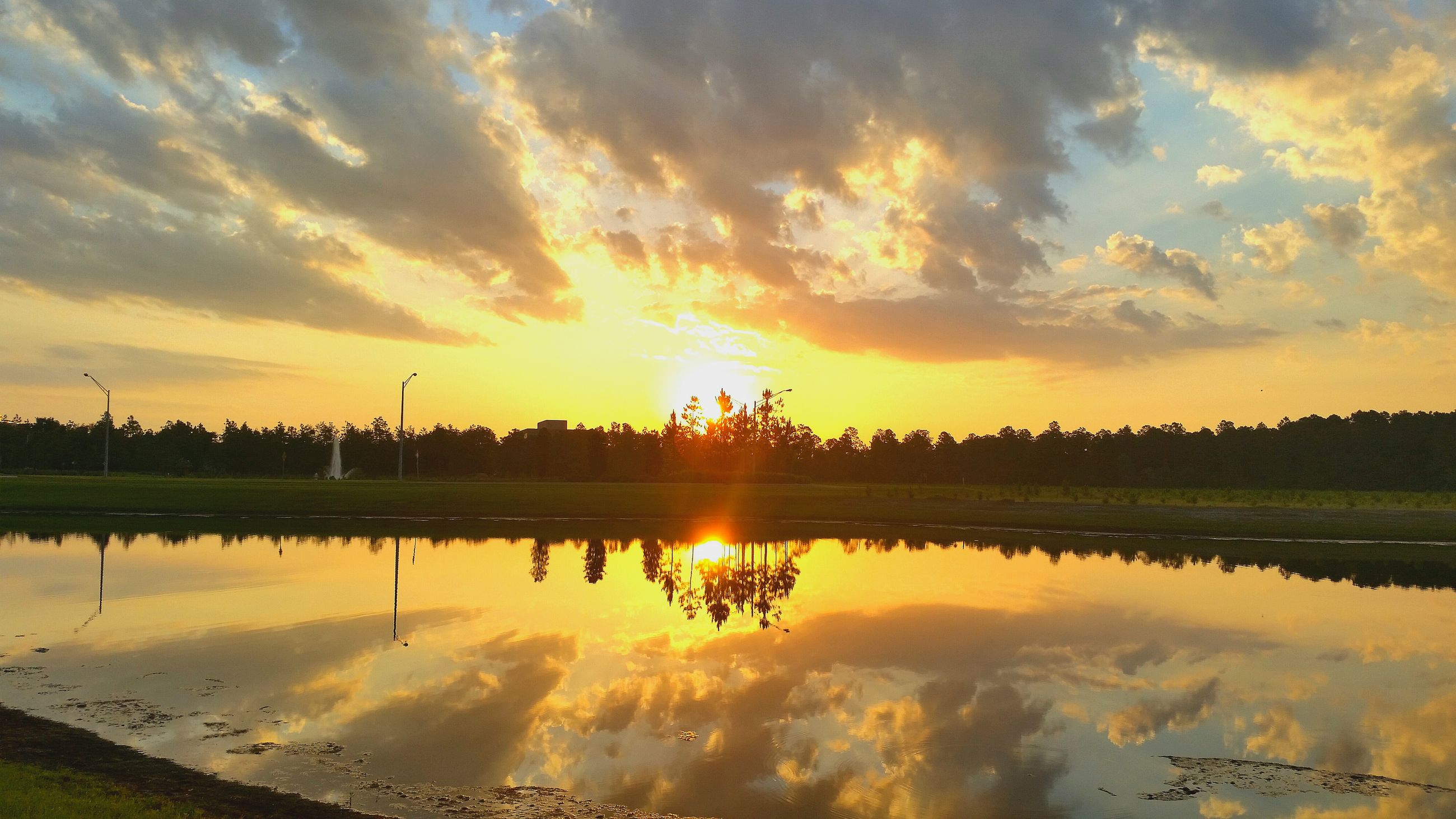 sunset, reflection, water, tranquil scene, sky, scenics, lake, sun, tranquility, beauty in nature, cloud - sky, orange color, idyllic, nature, silhouette, cloud, sunlight, cloudy, river, outdoors
