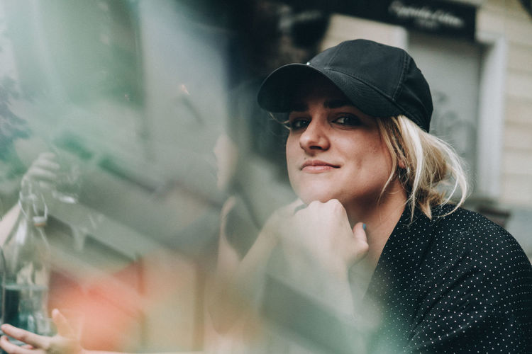#FREIHEITBERLIN Fashion Adult Bokeh Contemplation Hat Headshot Lifestyles Looking One Person Portrait Real People Selective Focus Women Young Adult