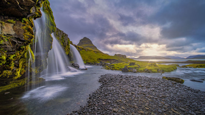 Kirkjufellsfoss waterfall is situated in Kirkjufellsa river and located near the proud mount Kirkjufell by Grundarfjordur town at the northern side of Snaefellsnes peninsula in West Iceland. Water Scenics - Nature Beauty In Nature Motion Environment Cloud - Sky Nature Sky No People Land Rock Waterfall Solid Long Exposure Rock - Object Travel Destinations Flowing Water River Blurred Motion Outdoors Flowing Stream - Flowing Water Power In Nature Falling Water Kirkjufellsfoss
