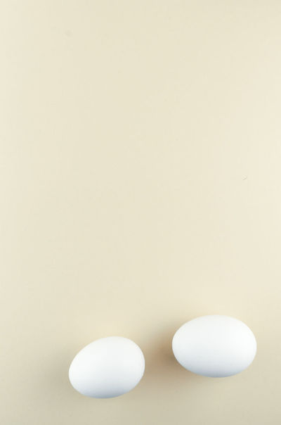 two eggs Studio Shot Indoors  Copy Space No People White Color Still Life Close-up White Background Dose Simplicity Group Of Objects Table Colored Background High Angle View Shape Wellbeing Eggs Minimalism White Eggs