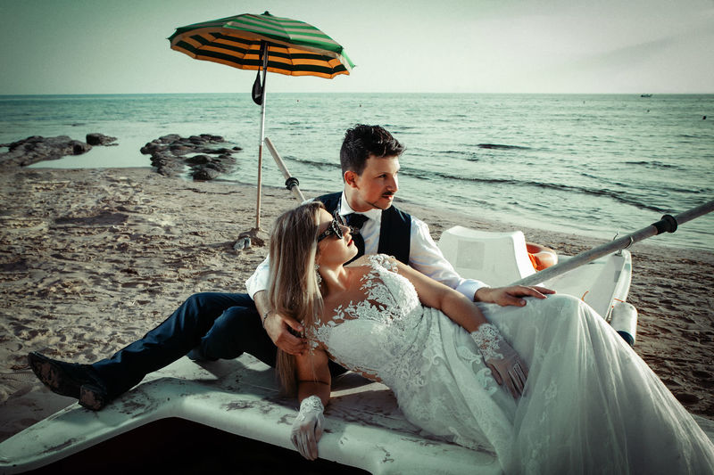 Adult Beach Couple - Relationship Hairstyle Horizon Horizon Over Water Land Men Nature Real People Sea Sitting Sky Two People Water Women Young Adult Young Men Young Women