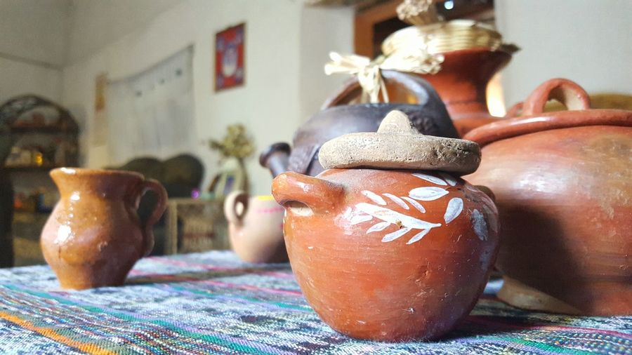 Close-up of earthen pots on table