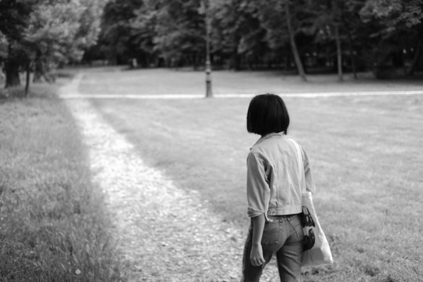 In the park, 2017 The Portraitist - 2017 EyeEm Awards Black And White Blackandwhite Light And Shadow Monochrome Rear View Real People One Person Field Day Outdoors Standing Lifestyles Nature Tree People Adult The Great Outdoors - 2017 EyeEm Awards EyeEmNewHere EyeEm Selects
